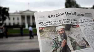 A man reads the front page of the New York Times featuring a picture of Osama bin Laden, in front of the White House in Washington, DC, on May 2, 2011.